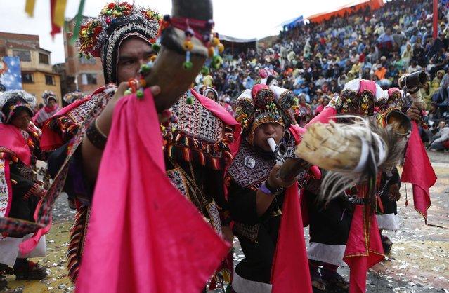 Pujllay dancers perform during the carnival celebrations in Oruro, Bolivia, Saturday February 14, 2015. (Photo by Juan Karita/AP Photo)