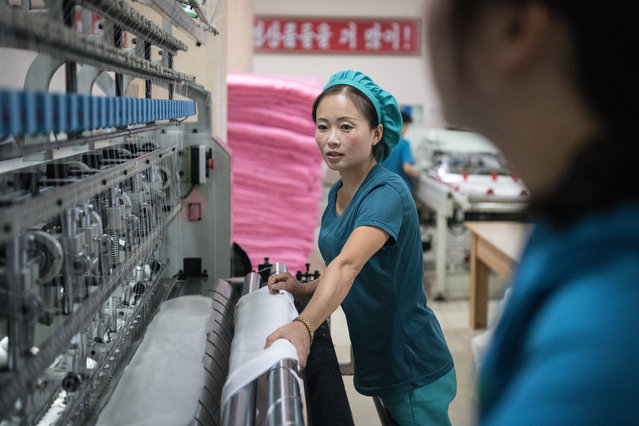 Women operate a machine in the Kim Jong Suk Silk Factory on August 21, 2018 in Pyongyang, North Korea. (Photo by Carl Court/Getty Images)