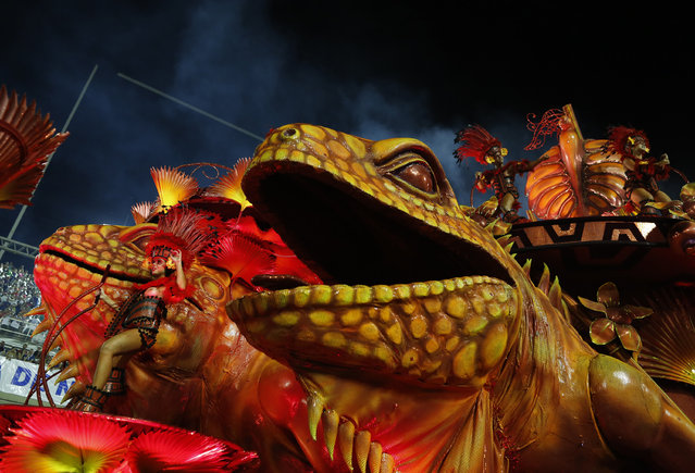 A performer from the Salgueiro samba school parades on a float during carnival celebrations at the Sambadrome in Rio de Janeiro, Monday, Feb. 16, 2015. (AP Photo/Leo Correa)