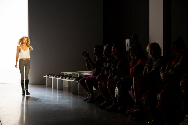 Designer Jeremy Scott and members of his team watch a model practice a run through before the Jeremy Scott Spring/Summer 2019 collection during New York Fashion Week in the Manhattan borough of New York City, U.S., September 6, 2018. (Photo by Caitlin Ochs/Reuters)