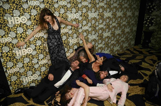 """The cast of """"Transparent"""" pose in various positions as they arrive at The HBO Golden Globe After Party in Beverly Hills, California January 10, 2016. (Photo by Mario Anzuoni/Reuters)"""