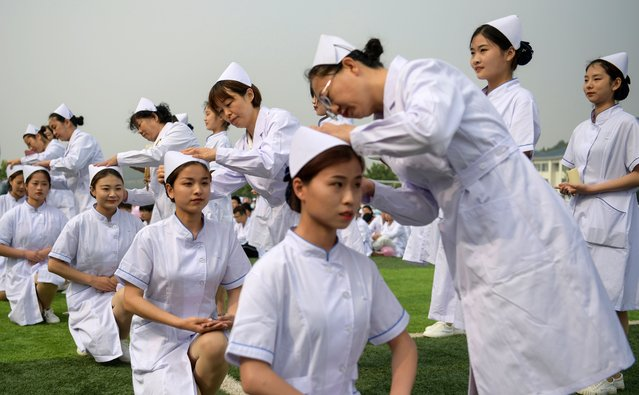 Nursing students attend a capping ceremony on May 10, 2021 in Jinan, Shandong Province of China. International Nurses Day is observed annually on May 12. (Photo by Zhang Yong/China News Service via Getty Images)