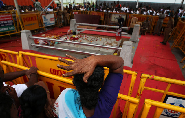 A supporter of Tamil Nadu Chief Minister Jayalalithaa Jayaraman mourns after visiting the Jayalalithaa's burial site in Chennai, India, December 7, 2016. (Photo by Adnan Abidi/Reuters)