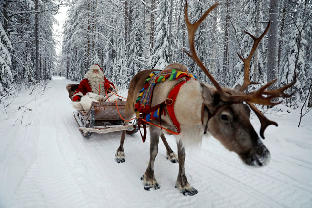 Santa Claus rides in his sleigh as he prepares for Christmas in the Arctic Circle near Rovaniemi, Finland December 15, 2016. (Photo by Pawel Kopczynski/Reuters)