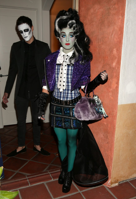 90210 starlet, Shenae Grimes, dressed as Monster High's Frankie Stein (R), and boyfriend, Josh Beech, leave for Matthew Morrison's 3rd Annual Halloween Party on October 28, 2012 in Los Angeles, California. (Photo by Christopher Polk/Getty Images for Mattel)