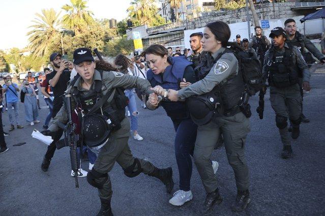 Israeli forces arrest Al Jazeera journalist, Givara Budeiri, during a protest in the east Jerusalem neighborhood of Sheikh Jarrah, Saturday, June 5, 2021. (Photo by Oren Ziv/AP Photo)