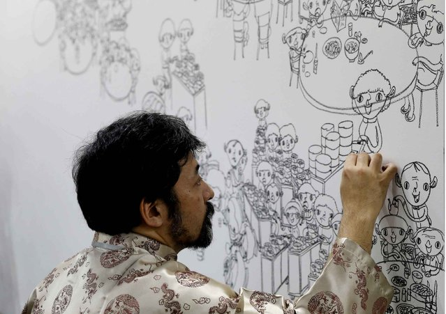 "Japanese artist Shintaro Miyake draws an artwork ""Excursions in Asia"" at his booth during the VIP preview of the art fair Art Basel in Hong Kong Friday, March 13, 2015. (Photo by Kin Cheung/AP Photo)"