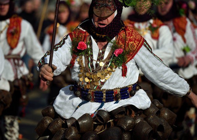"Mask dancers take part in a parade during the the International Festival of Masquerade Games ""Surva"" in the town of Pernik, some 30 km from Sofia, Bulgaria, January 31, 2016. (Photo by Vassil Donev/EPA)"