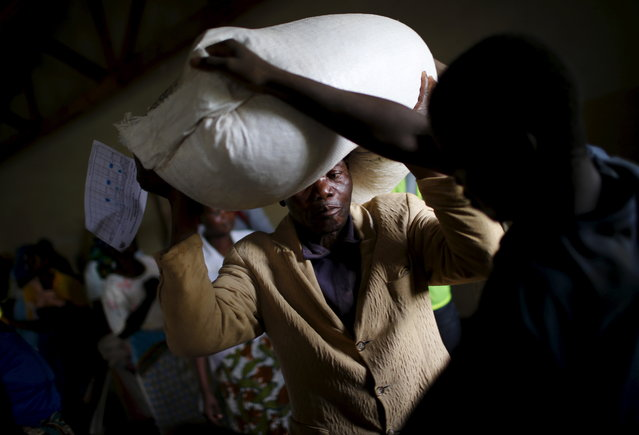 MALAWI: A man carries food aid distributed by the United Nations World Food Progamme (WFP) in Mzumazi village near Malawi's capital Lilongwe, February 3, 2016. (Photo by Mike Hutchings/Reuters)