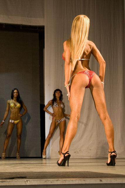 "Contestants pose during the ""Miss Bikini Fitness 2012"". Russia, Vladivostok"