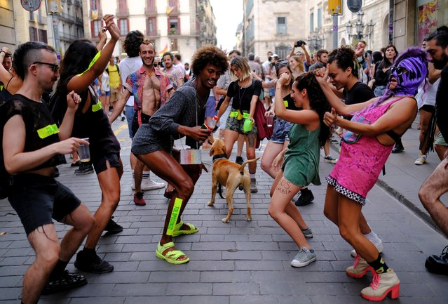 People dance at the end of a protest in support of sexual and gender liberation during Gay Pride month in Barcelona, Spain, June 26, 2021. (Photo by Nacho Doce/Reuters)