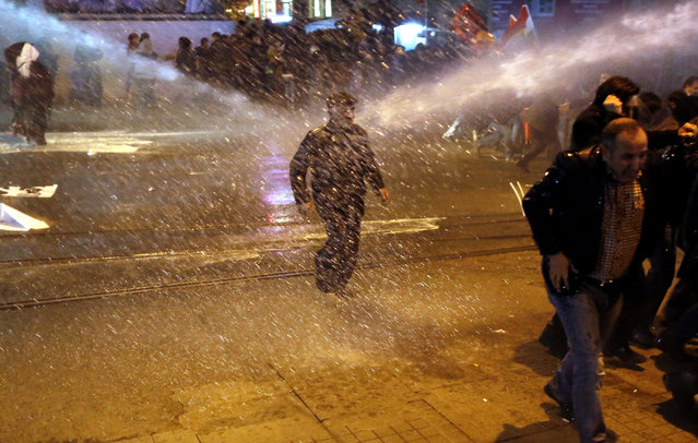 Turkish police fires water cannon to disperse the crowd during a protest against the Turkish government's security operations in eastern Turkey, in Istanbul, Turkey, 08 February 2016. The Turkish military has been fighting the Kurdistan Workers' Party (PKK) in the country's south-east since December 2015, with clashes between security forces and the party's Patriotic Revolutionary Youth Movement, YDG-H. (Photo by Cem Turkel/EPA)