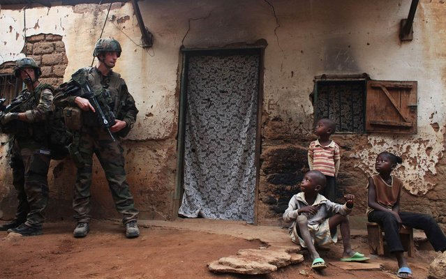French soldiers conduct a daytime patrol in a neighbourhood in Bangui, where shooting continued overnight in the capital, December 26, 2013. (Photo by Andreea Campeanu/Reuters)