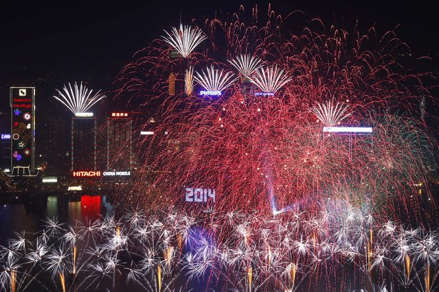 Fireworks explode at the Hong Kong Convention and Exhibition Centre. (Photo by Kin Cheung/Associated Press)
