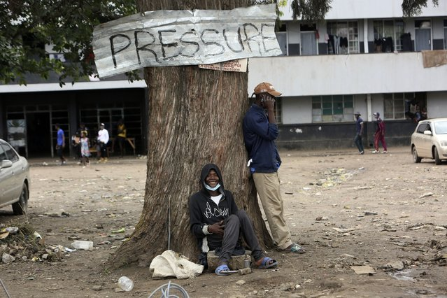 A man smiles while sitting under a tree in Harare, Zimbabwe, Wednesday, September 16, 2021. Zimbabwe has told all government employees to get vaccinated against COVID-19 or they will not be allowed to come to work. It wasn't made clear what would happen to those who refused to be vaccinated. (Photo by Tsvnagirayi Mukwazhi/AP Photo)
