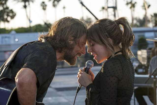 "This image released by Warner Bros. shows Bradley Cooper, left, and Lady Gaga in a scene from the latest reboot of the film, ""A Star is Born"". On Thursday, Dec. 6, 2018, the film was nominated for a Golden Globe award for best motion picture drama. The 76th Golden Globe Awards will be held on Sunday, Jan. 6. (Photo bt Neal Preston/Warner Bros. via AP Photo)"