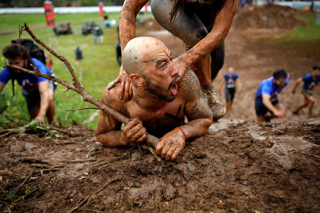 Participants take part in the Mud Run event in Tel Aviv, Israel on March 29, 2019. (Photo by Corinna Kern/Reuters)