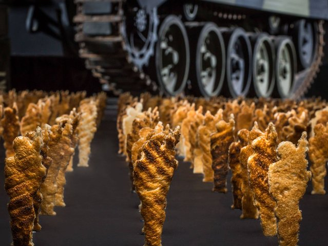 An army of 1,000 identical toast soldiers created by Eggs For Soldiers, deployed to raise funds for military charity Help for Heroes, to be displayed at London's Royal Artillery Museum, on March 1, 2014. (Photo by Eggs for Soldiers/PA Wire)