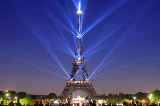 The Eiffel tower is illuminated during a light show to celebrate its 130th anniversary in Paris, France, May, 15, 2019. (Photo by Gonzalo Fuentes/Reuters)