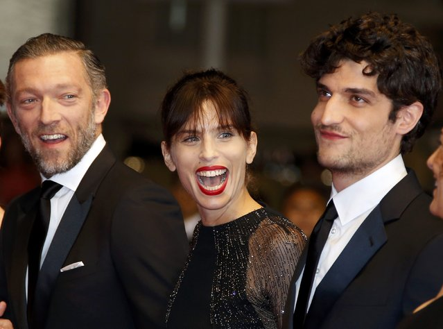 "Director Maiwenn (C), cast members Vincent Cassel (L) and Louis Garrel pose on the red carpet as they arrive for the screening of the film ""Mon roi"" in competition at the 68th Cannes Film Festival in Cannes, southern France, May 17, 2015. (Photo by Eric Gaillard/Reuters)"