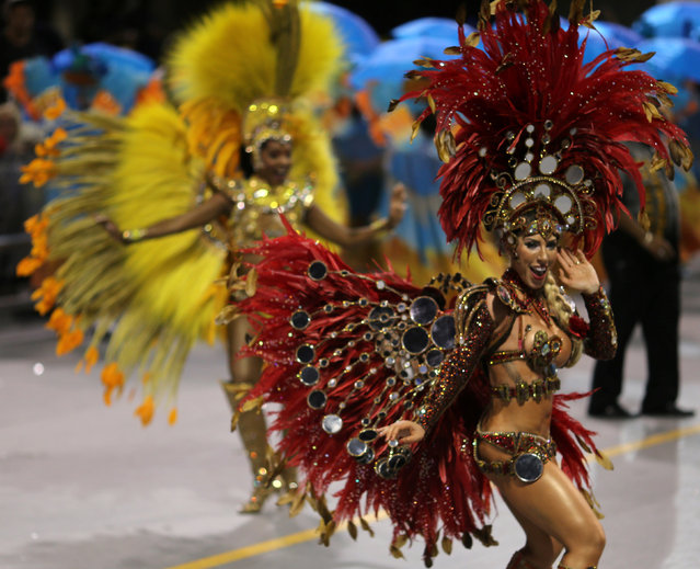 Revellers parade for the Gavioes da Fiel samba school during the carnival in Sao Paulo, Brazil, February 25, 2017. (Photo by Paulo Whitaker/Reuters)