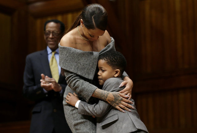 Rihanna, center, and Chase Sullivan, right, son of Harvard University professors, hug after the popular singer was presented with the 2017 Harvard University Humanitarian of the Year Award during ceremonies at the school, Tuesday, February 28, 2017, in Cambridge, Mass. Allen Counter, director of the Harvard Foundation, looks on behind left. (Photo by Steven Senne/AP Photo)