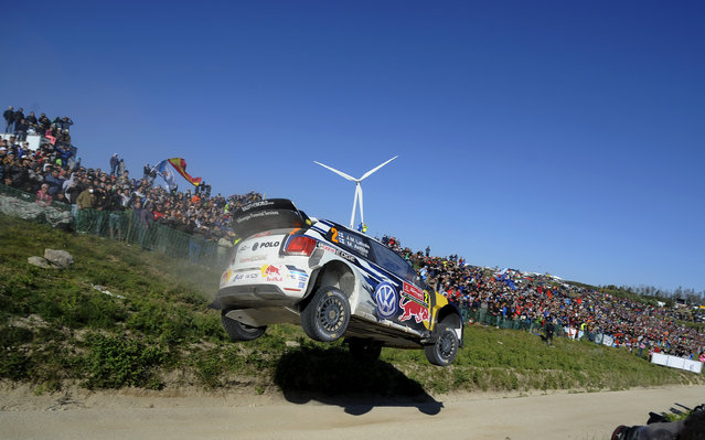 Volkswagen Motorsport driver Jari-Matti Latvala and his co-driver Miikka Anttila, both from Finland, steer their Volkswagen Polo R WRC3during the Portugal FIA World Rally Championship Sunday, May 24, 2015 in Lameirinha, Fafe, Portugal. (Photo by Paulo Duarte/AP Photo)