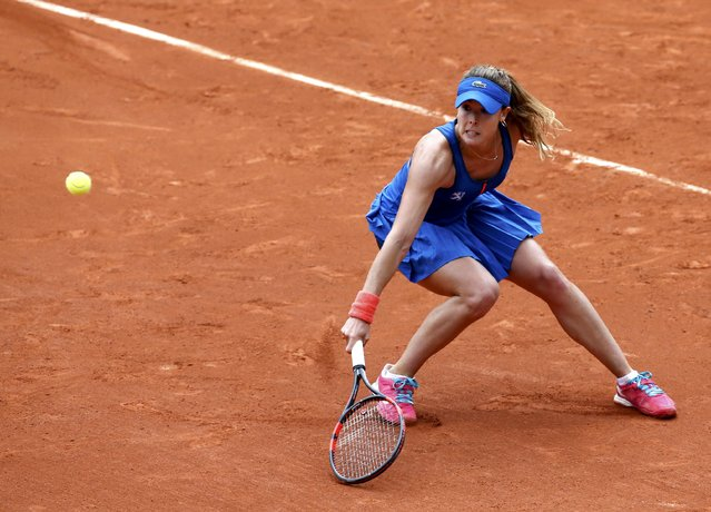Alize Cornet of France plays a shot to  Roberta Vinci of Italy during their women's singles match at the French Open tennis tournament at the Roland Garros stadium in Paris, France, May 25, 2015. (Photo by Jean-Paul Pelissier/Reuters)