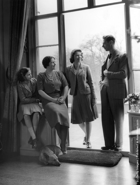 1942: King George VI relaxes with his wife, the Queen Consort Elizabeth, and his children, Princesses Elizabeth and Margaret at the Royal Lodge, Windsor