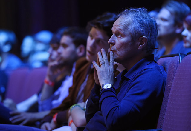 Ubisoft CEO Yves Guillemot watches the stage presentation from the front row at Ubisoft's E3 2015 Conference at the Orpheum Theatre on Monday, June 15, 2015, in Los Angeles. (Photo by Chris Pizzello/Invision/AP)