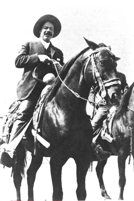 Mexican revolutionary Pancho Villa (1878 - 1923) smiles while sitting on horseback, c. 1911
