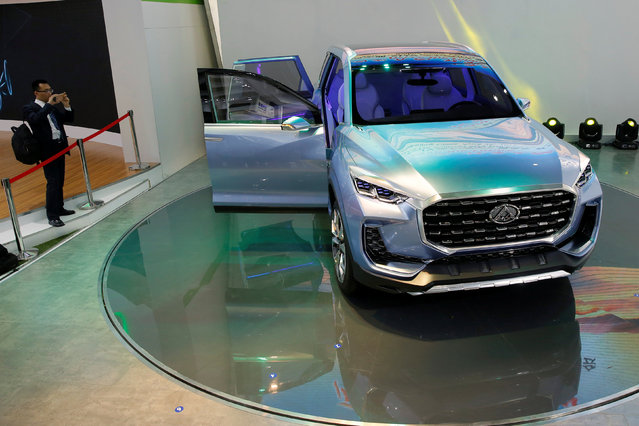 A man takes a picture of SAIC Motor Corp's MAXUS Concept SUV D90 during Auto China 2016 auto show in Beijing, China April 25 2016. (Photo by Kim Kyung-Hoon/Reuters)