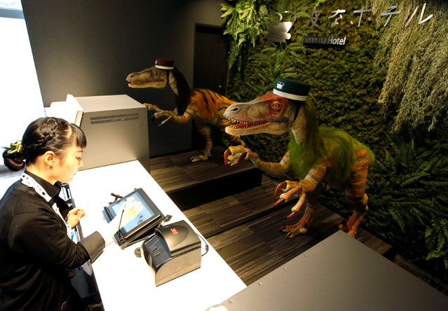 "Dinosaur robots acting as receptionist greet a hotel employee demonstrating how to check-in to the hotel during a press preview for the newly-opening Henn na Hotel Maihama Tokyo Bay in Urayasu, east of Tokyo, Japan March 15, 2017. The reception desk is handled by robots that speak Japanese, English, Chinese and Korean, as well as porter robots that help guests carry luggage to their rooms. Tasks such as window-cleaning and vacuuming are also handled by robots. Japan's second robot-run hotel Henn na Hotel (""strange hotel"" in Japanese) opened on March 15, 2017 as the robot-staffed hotel near Tokyo, operating company H.I.S. Co. said. (Photo by Issei Kato/Reuters)"