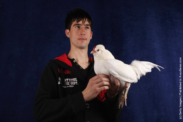 David Davis, from South Wales, holds his 3 year old White Araucana