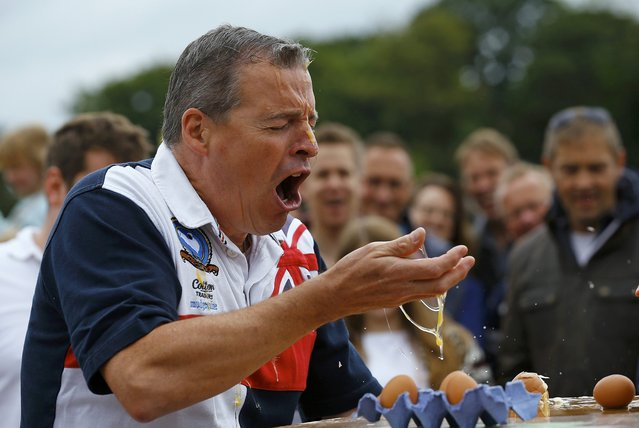 A man reacts after losing a game of Russian Egg Roulette during the World Egg Throwing Championships and Vintage Day in Swaton, Britain June 28, 2015. (Photo by Darren Staples/Reuters)