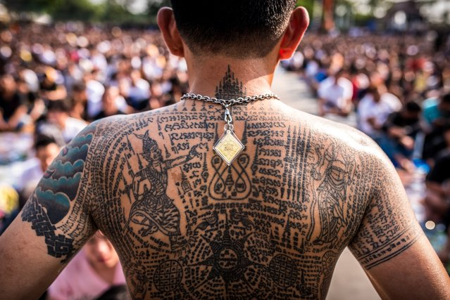 The intircate Thai tattoos – called San Yant – provide different protections to their wearer, on March 11, 2017 in Nakhon Chai Si, Thailand. Devoted Buddhists enter feverish trances as they recharge the magical protection of their sacred tattoos. Every March, pilgrims gather at Wat Bang Phra – a large Buddhist temple near Thailand's capital Bangkok - to reenergise the protective magic of their sacred Sak Yant tattoos. In the days before the main event, monks tattoo hundreds, if not thousands, of Buddhists eager to reaffirm the magical protection infused into their intricate body art. (Photo by Claudio Sieber/Barcroft Images)