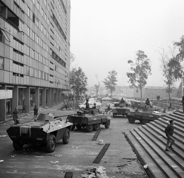 """In this October 3, 1968 file photo, armored cars are lined up on the Plaza of the Three Cultures in Mexico City, after fierce clashes the previous night between Mexican forces and striking students. As Mexico marks the 50-year anniversary of Tlatelolco, the massacre remains something of an open wound: Nobody knows exactly how many died when soldiers opened fire on a peaceful demonstration, and it wasn't until 2018 that a government agency acknowledged for the first time that it was """"a state crime"""". (Photo by AP Photo)"""