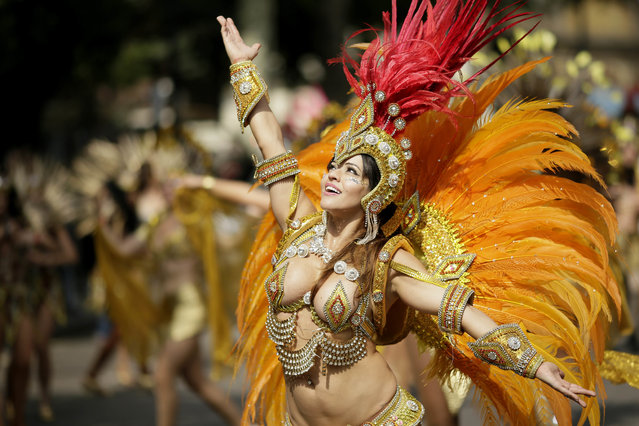 Costumed revellers perform in the parade during the Notting Hill Carnival in London, Monday, August 27, 2018. The carnival has been held every year since 1966 and one of the largest festival celebrations of its kind in Europe. (Photo by Tim Ireland/AP Photo)