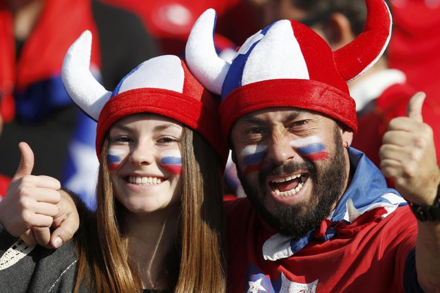 Chile fans cheer ahead of the team's Copa America 2015 final soccer match against Argentina at the National Stadium in Santiago, Chile, July 4, 2015. (Photo by Henry Romero/Reuters)