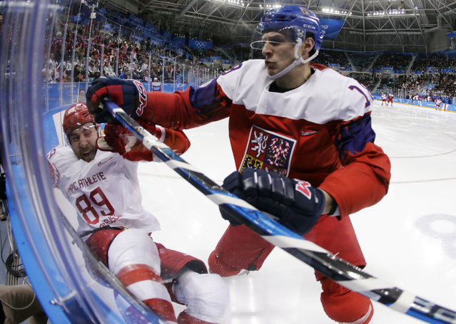 In this February 23, 2018, file photo, Czech Republic' Dominik Kubalik (18) checks Russia's Nikita Nesterov (89) during the second period of the semifinal round of the men's hockey game at the 2018 Winter Olympics in Gangneung, South Korea. Kubalik is one of the biggest variables for the Chicago Blackhawks as they try to get back to the playoffs after a two-year absence. He could play on one of Chicago's top lines, but he isn't looking too far ahead early in training camp. (Photo by Julio Cortez/AP Photo/File)