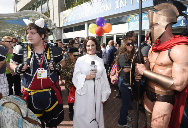 "A reporter, dressed as Princess Leia from the ""Star Wars"" films, interviews costumed characters in front of the convention center on the first day of the 2015 Comic-Con International at the San Diego Convention Center, Thursday, July 9, 2015 in San Diego. (Photo by Denis Poroy/Invision/AP Photo)"
