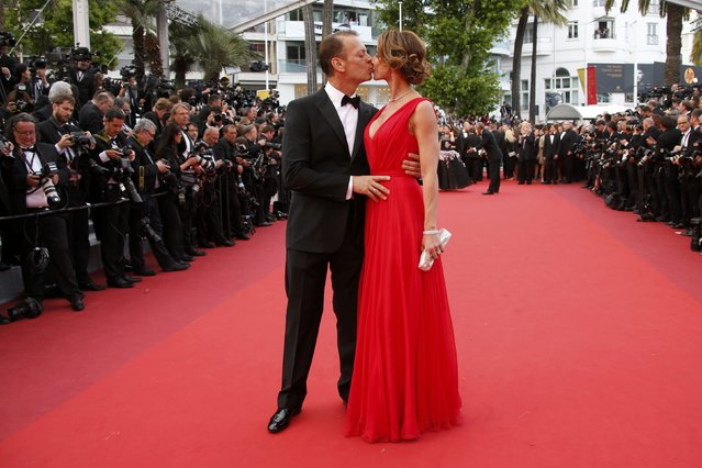 """Rocco Siffredi and his wife pose on the red carpet as they arrive for the screening of the film """"Money Monster"""" out of competition during the 69th Cannes Film Festival in Cannes, France, May 12, 2016. (Photo by Jean-Paul Pelissier/Reuters)"""