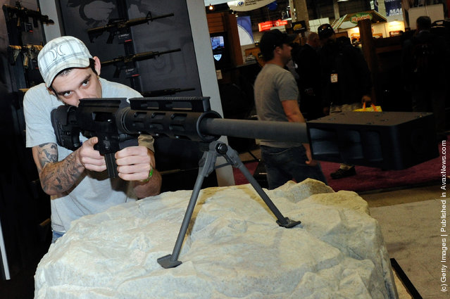 Chris Everhart looks at a Bushmaster BA-50 bolt action rifle at the Bushmaster Firearms booth at the National Shooting Sports Foundation's 34th annual Shooting, Hunting, Outdoor Trade (SHOT) Show