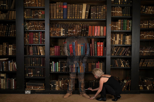 Armed forces veteran Frank Simpson at the Portico library being camouflaged by body artist Carolyn Roper in Manchester, UK on May 16, 2016 as part of the #CountThemIn campaign launched on Monday by the Royal British Legion. (Photo by Jon Super/Royal British Legion/PA Wire)