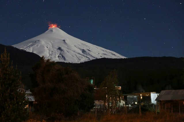 The Villarrica volcano spews lava at night, as seen from the town of Pucon, Chile on September 9, 2019. (Photo by Cristobal Saavedra/Reuters)
