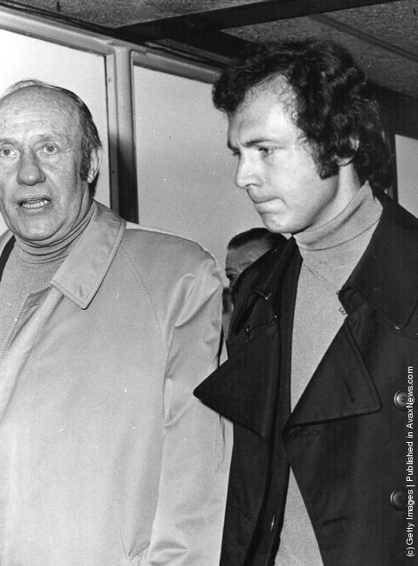 1975: Franz Beckenbauer West German football player, coach and manager arriving at Heathrow airport with Helmut Schoen