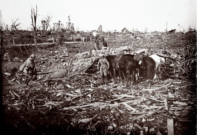 An archive picture shows soldiers and horses amid a destroyed spot on the battlefield at Maurepas on the Somme front, northern France October 1916. (Photo by Collection Odette Carrez/Reuters)