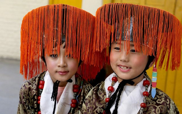 Tibetan boys living-in-exile in India wearing tradtional clothes wait to participate in a cultural program to celebrate the 59th anniversary of Tibetan Democracy Day at the main Tibetan Tsuglagkhang temple in McLeod Ganj, near Dharamsala, India, 02 September 2019. On 02 September 1960, the first members of the Tibetan Parliament-in-exile in India formally took their oath of office, establishing the democratic system of Tibet. (Photo by Sanjay Baid/EPA/EFE/Rex Features/Shutterstock)