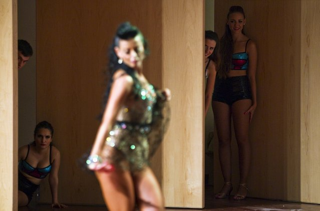 Participants watch from backstage as another performs during a Latin dance competition in Tel Aviv, Israel July 18, 2015. (Photo by Amir Cohen/Reuters)