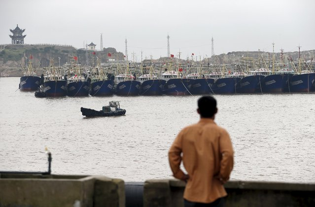 Fishing boats are seen anchored in a bay as Typhoon Chan-Hom approaches southern China, in Wenling, Zhejiang province, July 8, 2015. Chinese authorities have suspended train services, closed schools and bought trawlers back to port before two typhoons in the south and east of the country make landfall later this week, state media said. (Photo by William Hong/Reuters)